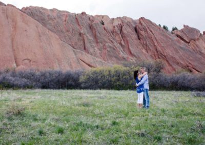 Littleton photographer Colorado red rocks in love couple engaged engagement session